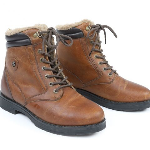 Short brown country walking boots with fleece lining and lace up fronts on a plain white background